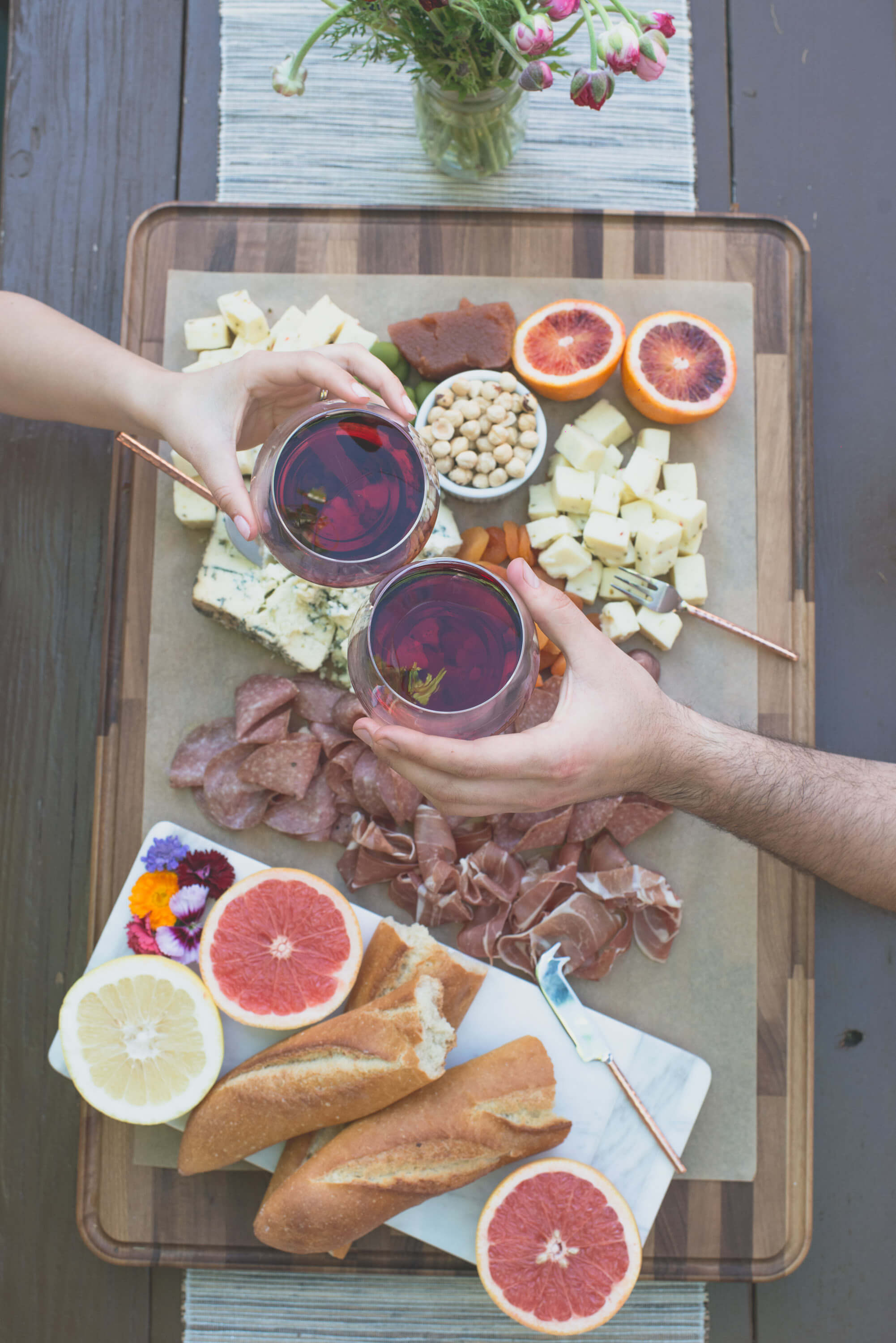 charcuterie and red wine toast